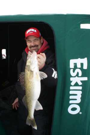 Rick Olson was on the clock for this big early ice walleye