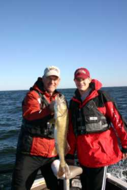 Man and son holding walleye
