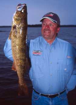 John Kolinski the author hoists a fine walleye