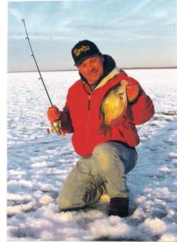 the author John Kolinski hoists a nice ice crappie