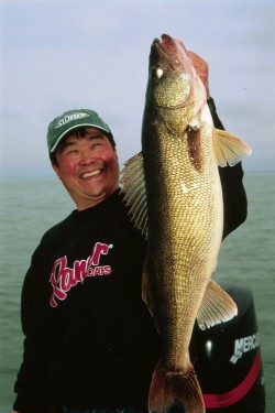 Ted Takasaki holding a nice walleye