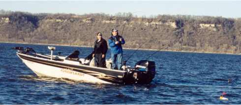 Rick Olson and his partner Norb Wallock prepare to reel in a nice walleye taken while trolling