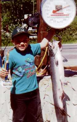 Karl Swanson 8 of Homer Ak shows off his prize winning catch