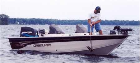 Norb Wallock gets ready to set the anchor on his Crestliner boat
