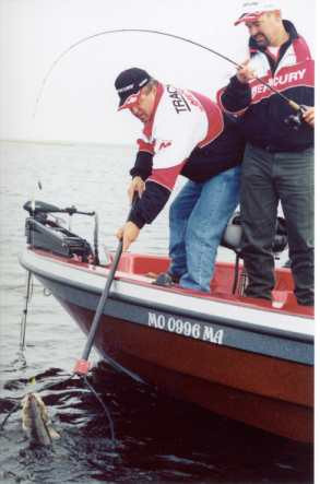 Norb Wallock nets a bootm bouncer walleye for Rick Olson
