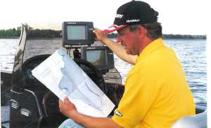 John studies maps and his Lowrance unit before going to far