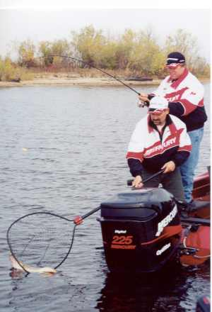 Rick Olson nets a fine walleye for Norb Wallock