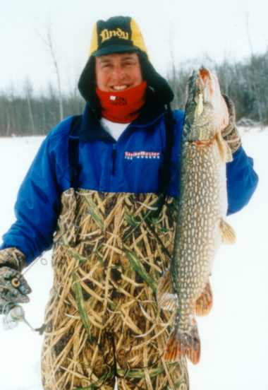 Tommy Skarlis with a fine Northern Pike dragged up through the ice